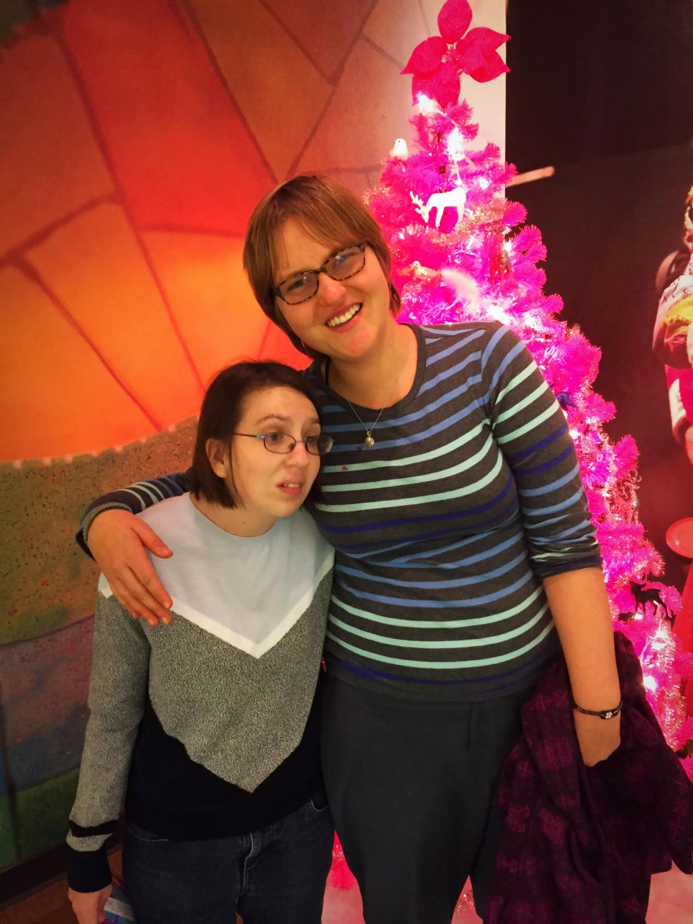 Emma and Christine at the Alliance with Pink Xmas Tree